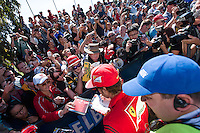 March 13, 2014: Fernando Alonso (ESP) from the Scuderia Ferrari team signs autographs at the 2014 Australian Formula One Grand Prix at Albert Park, Melbourne, Australia. Photo Sydney Low.