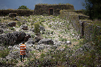 April 9th, 2011_HAITI_ Remains of an ancient fort built after Haiti's slave rebellion sits along the road which links Port Solut to Park Makaya, which is south west of the Haitian capital city of Port au Prince. Park Makaya is in an extremely remote area of Haiti and is known to be a biodiversity hotspot.  Photographer: Daniel J. Groshong/The Hummingfish Foundation