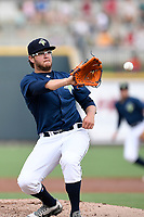 Starting pitcher Anthony Kay (18) of the Columbia Fireflies protects himself by grabbing a batted ball in a game against the Greenville Drive on Saturday, May 26, 2018, at Spirit Communications Park in Columbia, South Carolina. Columbia won, 9-2. (Tom Priddy/Four Seam Images)