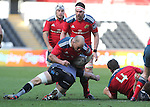 Ospreys captain Justin Tipuric tackles Munster hooker BJ Botha.<br /> Guiness Pro12<br /> Ospreys v Munster<br /> Liberty Stadium<br /> 07.03.15<br /> &copy;Steve Pope - SPORTINGWALES