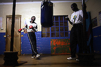 SOWETO, SOUTH AFRICA OCTOBER 25: Funsi Monta, age 17, a South African boxing champion, trains in a gym on October 25, 2006 in Soweto, Johannesburg, South Africa. He trains every day with his trainer in a hall without any proper equipment. Soweto is South Africa&rsquo;s largest township and it was founded about one hundred years to make housing available for black people south west of downtown Johannesburg. The estimated population is between 2-3 million. Many key events during the Apartheid struggle unfolded here, and the most known is the student uprisings in June 1976, where thousands of students took to the streets to protest after being forced to study the Afrikaans language at school. Soweto today is a mix of old housing and newly constructed townhouses. A new hungry black middle-class is growing steadily. Many residents work in Johannesburg, but the last years many shopping malls have been built, and people are starting to spend their money in Soweto.  <br /> (Photo by Per-Anders Pettersson)