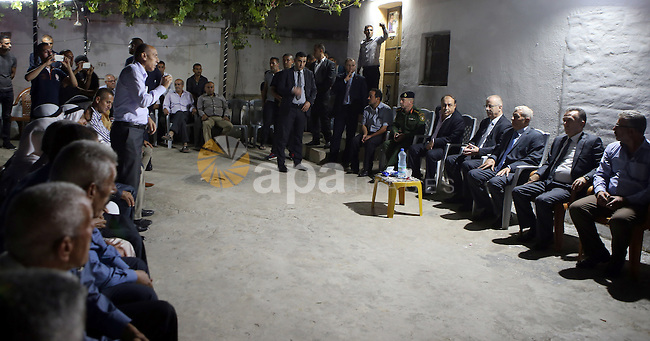 Palestinian Prime Minister Rami Hamdallah offers condolences to the Family of Palestinian Yasser Nazzal, in the West Bank, City of Jenin, on July 10, 2016. Photo by Prime Minister Office