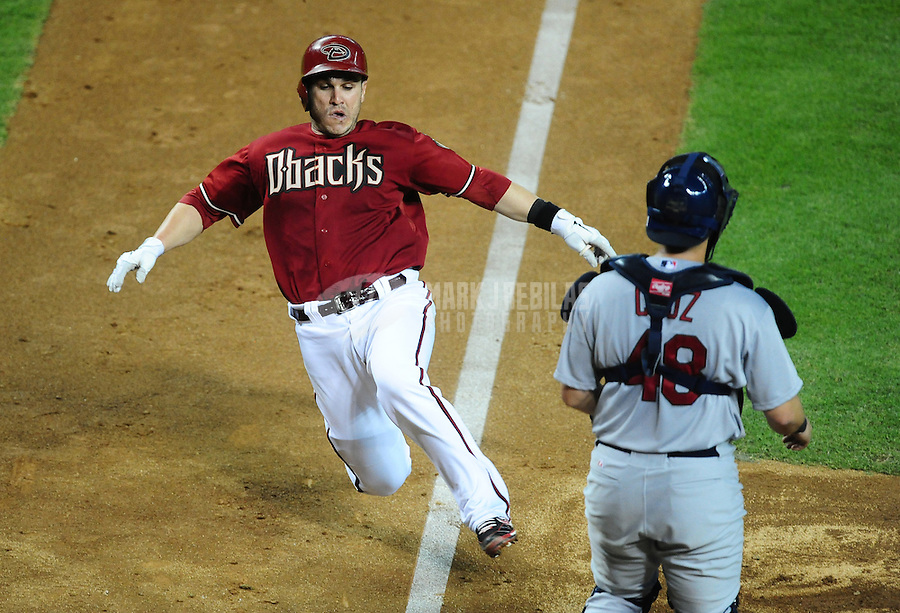 May 9, 2012; Phoenix, AZ, USA; Arizona Diamondbacks catcher Miguel Montero scores in the sixth inning against the St. Louis Cardinals at Chase Field. The Cardinals defeated the Diamondbacks 7-2. Mandatory Credit: Mark J. Rebilas-
