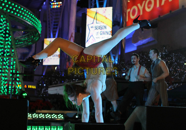 CIRQUE BERZERK .The Holiday Tree Lighting At L.A. Live & Opening Of L.A. Kings Holiday Ice held At L.A Live,  Los Angeles, CA, USA, .4th December 2010..concert live on stage circus performing  show full length performer black hand stand standing on hands .CAP/ADM/KB.©Kevan Brooks/AdMedia/Capital Pictures.