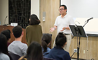 Nick Yeh '17 leads the InterVarsity Large Group meeting on Maundy Thursday of Holy Week. The meeting, in Lower Herrick, was well-attended and culminated with the Washing of Feet ceremony. March 24, 2016.<br />