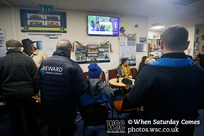 Fans catching up with the latest scores on SKY in the bar at half time. Penrith AFC V Hebburn Town, Northern League Division One, 22nd December 2018. Penrith are the only Cumbrian team in the Northern League. All the other teams are based across the Pennines in the north east.<br /> Penrith, winless at kick off, lost a thriller 3-4, in front of 100 people. They won five games all season, but were reprieved from relegation following Blyth's resignation from the league.