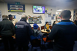 Fans catching up with the latest scores on SKY in the bar at half time. Penrith AFC V Hebburn Town, Northern League Division One, 22nd December 2018. Penrith are the only Cumbrian team in the Northern League. All the other teams are based across the Pennines in the north east.<br />