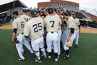 The Wake Forest Demon Deacons huddle up prior to the start of their game against the UNCG Spartans at David F. Couch Ballpark on February 21, 2017 in  Winston-Salem, North Carolina.  The Demon Deacons defeated the Spartans 15-8.  (Brian Westerholt/Four Seam Images)