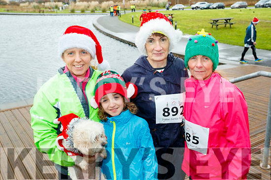 Jenny Barry, Sean Barry (Tralee) with Noreen Quirke (Farmersbridge) and Carmel Foran (Monalee), pictured taking part in the Santa Run at Tralee Bay Wetlands on Sunday morning last.