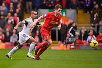 Sunday, 23 February 2014<br /> Pictured: Swansea City's Wayne Routledge chases down Liverpool's Jon Flanagan<br /> Re: Barclay's Premier League, Liverpool FC v Swansea City FC v at Anfield Stadium, Liverpool Merseyside, UK.