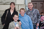 Saleem Bellout who made his First Communion at Our Lady of Lourdes Church on Saturday 16th May, pictured with mum Eithne Reilly, brother James Reilly and uncle and godfather Derek Reilly.