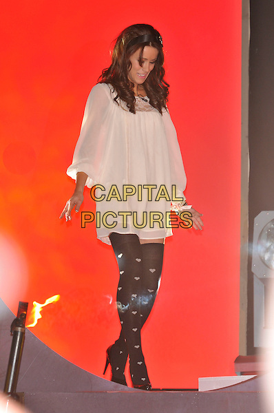 NICOLA T aka Nicola Tappenden.Contestants enter the House on the Opening Night of Celebrity Big Brother, Elstree Studios, London, England..January 3rd, 2010.CBB BB full length white cream tunic smock dress heart print black otk over the knee high socks looking down.CAP/PL.©Phil Loftus/Capital Pictures.