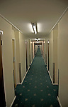 Long hotel corridor with neon lights