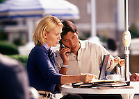 Adult man and woman in casual outdoor business meeting.