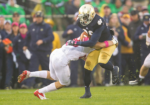 October 13, 2012:  Notre Dame running back Cierre Wood (20) during NCAA Football game action between the Notre Dame Fighting Irish and the Stanford Cardinal at Notre Dame Stadium in South Bend, Indiana.  Notre Dame defeated Stanford 20-13.
