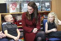 22 February 2017 - Princess Kate Duchess of Cambridge sits next to 7 year old Alife Thomas and 9 year old Emily Davis as she visits Caerphilly Family Intervention Team (FIT) to learn about their work with children with emotional and behavioural difficulties, problems with family relationships and those who have or who are likely to self-harm in Caerphilly. Photo Credit: ALPR/AdMedia