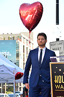 LOS ANGELES, CA. November 16, 2018: Michael Buble & Tom Corson at the Hollywood Walk of Fame Star Ceremony honoring singer Michael Bublé.<br /> Pictures: Paul Smith/Featureflash