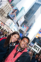 U.S. women national team midfielder Carli Lloyd poses for a photo with a fan during the centennial celebration of U. S. Soccer at Times Square in New York, NY, on April 04, 2013.