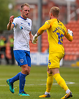 Portsmouth's Matt Clarke celebrates his side's second goal with Craig MacGillivray<br /> <br /> Photographer Alex Dodd/CameraSport<br /> <br /> The EFL Sky Bet League One - Blackpool v Portsmouth - Saturday August 11th 2018 - Bloomfield Road - Blackpool<br /> <br /> World Copyright &copy; 2018 CameraSport. All rights reserved. 43 Linden Ave. Countesthorpe. Leicester. England. LE8 5PG - Tel: +44 (0) 116 277 4147 - admin@camerasport.com - www.camerasport.com