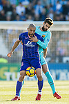 Nourredine Amrabat of CD Leganes (front) fights for the ball with Gerard Pique Bernabeu of FC Barcelona  (back) during the La Liga 2017-18 match between CD Leganes vs FC Barcelona at Estadio Municipal Butarque on November 18 2017 in Leganes, Spain. Photo by Diego Gonzalez / Power Sport Images