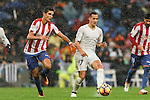 Lucas Vazquez of Real Madrid battles for the ball with Rachid Ait-Atmane of Real Sporting de Gijon during the La Liga match between Real Madrid and Real Sporting de Gijon at the Santiago Bernabeu Stadium on 26 November 2016 in Madrid, Spain. Photo by Diego Gonzalez Souto / Power Sport Images