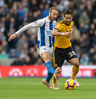 Brighton &amp; Hove Albion's Glenn Murray (left) battles with Wolverhampton Wanderers' Joao Moutinho (right) <br /> <br /> Photographer David Horton/CameraSport<br /> <br /> The Premier League - Brighton and Hove Albion v Wolverhampton Wanderers - Saturday 27th October 2018 - The Amex Stadium - Brighton<br /> <br /> World Copyright &copy; 2018 CameraSport. All rights reserved. 43 Linden Ave. Countesthorpe. Leicester. England. LE8 5PG - Tel: +44 (0) 116 277 4147 - admin@camerasport.com - www.camerasport.com