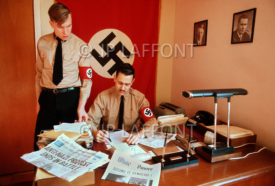 February 10, 1972, Arlington, Virginia. Matt Koehl, the comander of the White National Socialist Party at a desk talking with the party secratary about recent newspaper reaction to the boicot of the busing.
