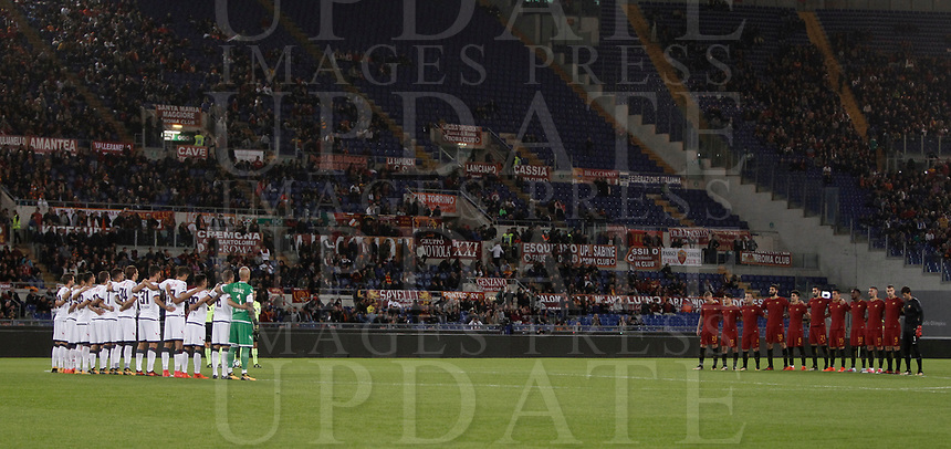 "Calcio, Serie A: Roma, stadio Olimpico, 25 ottobre 2017.<br /> AS Roma's and Crotone's players listen to a speaker reading a passage from the diary of holocaust victim Anne Frank before the Italian Serie A football match between AS Roma and Crotone at Rome's Olympic stadium, October 25, 2017.<br /> Few days ago Lazio fans posted anti-semitic photos of Anne Frank in a Roma jersey in the stands of the Stadio Olimpico. The Italian football federation announced that there will be a minute's reflection on the Holocaust before every match and a passage read from ""The Diary of Anne Frank"". At the same time referees and captains will hand out copies of the diary and Italian Jewish writer Primo Levi's memoir ""If This Is A Man"".<br /> UPDATE IMAGES PRESS/Isabella Bonotto"