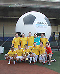 "All My Children's Mark Consuelos poses with the winning team Grassrootsoccer at the ""Kicking It"" at the Annual Tribeca/NYFEST Soccer Day Celebrity Exhibition on April 21, 2012 - NYFEST (which stands for New York Film and Entertainment Soccer Tournament) was designed to mesh the worlds of entertainment, soccer and New York City in conjunction with the Tribeca Film Festival. The day included a film and entertainment industry tournament with 44 teams with one winner the GrassrootsSoccer team which Mark Consuelos played on. Grassroots was cofounded by Survivor winner Ethan Zohn. The all-day event took place at Pier 40 in Manhattan, and consisted of an industry tournament, a youth showcase, and a celebrity soccer tournament.  (Photo by Sue Coflin/Max Photos)"