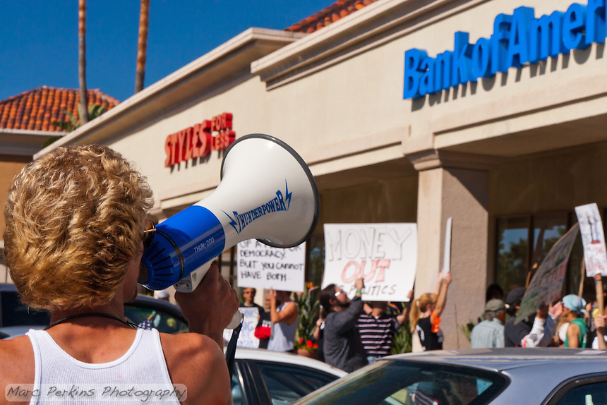 """""""Web"""" (Andrew) leads a chant at a Bank of America in Irvine, CA during the Occupy Orange County, Irvine march on Saturday November 5."""