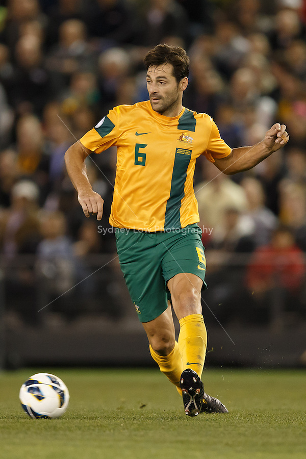 MELBOURNE, 11 JUNE 2013 - Sasa OGNENOVSKI of Australia passes the ball in a Round 4 FIFA 2014 World Cup qualifier match between Australia and Jordan at Etihad Stadium, Melbourne, Australia. Photo Sydney Low for Zumapress Inc. Please visit zumapress.com for editorial licensing. *This image is NOT FOR SALE via this web site.