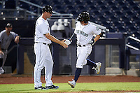 Peoria Javelinas Tyler O'Neill (11), of the Seattle Mariners organization, is congratulated by manager Jared Sandberg after hitting a home run during a game against the Glendale Desert Dogs on October 18, 2016 at Peoria Stadium in Peoria, Arizona.  Peoria defeated Glendale 6-3.  (Mike Janes/Four Seam Images)