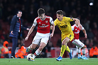 Kieran Tierney of Arsenal in action as Gojko Cimirot of Standard Liege looks on during Arsenal vs Standard Liege, UEFA Europa League Football at the Emirates Stadium on 3rd October 2019
