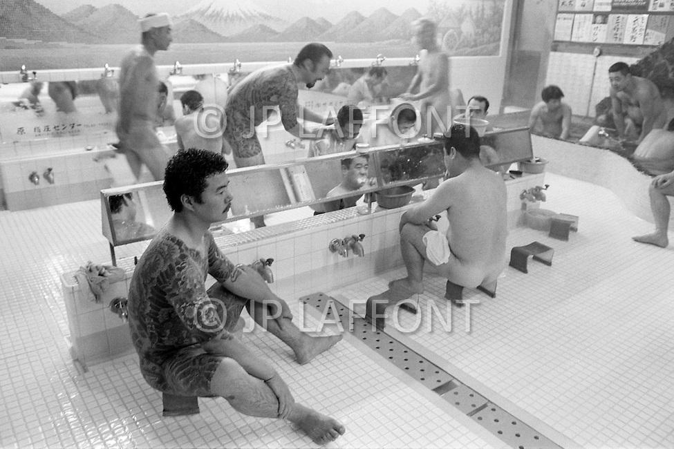 October 1980, Tokyo, Japan --- In Ueno neighborhood, Tsubameyu Public Bath only allows entrance to tattooed men. --- Image by © JP Laffont
