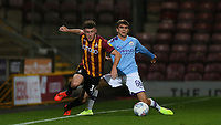 Iker Pozo La Rosa of Man City attempts to tackle Shay McCartan of Bradford City during the The Leasing.com Trophy match between Bradford City and Manchester City U21 at the Utilita Energy Stadium, Bradford, England on 24 September 2019. Photo by Thomas Gadd.