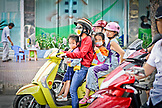 VIETNAM, Ho Chi Minh, Motorcycle Traffic, Two Women and Two Girls riding one motorcycle,
