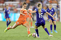 Houston, TX - Saturday June 17, 2017: Amber Brooks clears the ball from her side of the field during a regular season National Women's Soccer League (NWSL) match between the Houston Dash and the Orlando Pride at BBVA Compass Stadium.