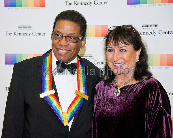 2013 Kennedy Center Honor recipient Herbie Hancock and his wife, Gigi, arrives for the formal Artist's Dinner honoring the recipients of the 39th Annual Kennedy Center Honors hosted by United States Secretary of State John F. Kerry at the U.S. Department of State in Washington, D.C. on Saturday, December 3, 2016. The 2016 honorees are: Argentine pianist Martha Argerich; rock band the Eagles; screen and stage actor Al Pacino; gospel and blues singer Mavis Staples; and musician James Taylor. Photo Credit: Ron Sachs/CNP/AdMedia