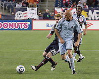 New England Revolution midfielder Pat Phelan (28) and Colorado Rapids forward Conor Casey (9) contend for the ball.  The Colorado Rapids defeated the New England Revolution, 2-1, at Gillette Stadium on April 24.2010