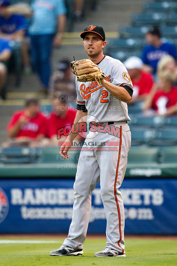 Baltimore Orioles shortstop JJ Hardy #2 warms up before the Major League Baseball game against the Texas Rangers on August 21st, 2012 at the Rangers Ballpark in Arlington, Texas. The Orioles defeated the Rangers 5-3. (Andrew Woolley/Four Seam Images).