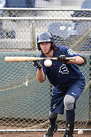 Conner Hale (39) of the Everett AquaSox practices bunting before a game against the Spokane Indians at Everett Memorial Stadium on July 25, 2015 in Everett, Washington. Spokane defeated Everett, 10-1. (Larry Goren/Four Seam Images)