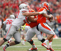 Illinois Fighting Illini quarterback Nathan Scheelhaase (2) is nabbed by Ohio State Buckeyes defensive lineman Joey Bosa (97) during Saturday's NCAA Division I football game at Memorial Stadium in Champaign, Il., on November 16, 2013. Ohio State won the game 60-35. (Barbara J. Perenic/The Columbus Dispatch)