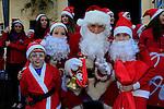 Joshua Richards Olivia Smith Aine O'Brien with Santa at the Drogheda Christmas Bonanza santa parade<br /> Picture: Fran Caffrey www.newsfile.ie