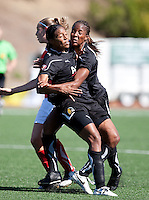 Candace Chapman (left) collides with Kandace Wilson (right) on the play. FC Gold Pride defeated the Washington Freedom 3-2 at Pioneer Stadium in Hayward, California on July 11th, 2010.