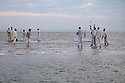 11/09/14 <br /> <br /> The first few balls are bowled before the 'wicket' appears.<br /> <br /> ***Caption Correction  - Cowes not Ryde as in previous****<br /> <br /> Rival teams from the Royal Southern Yacht Club and The Island Sailing Club compete in a game of cricket on the Brambles Bank sandbank at dawn. The sandy wicket only appears for a few minutes on the lowest tide of the year in the middle of the Solent between Cowes and Southampton.<br /> <br /> All Rights Reserved - F Stop Press.  www.fstoppress.com. Tel: +44 (0)1335 300098