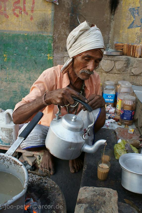 Man at river Ganga in Varanasi selling Masala tea