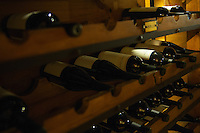 Malbec wines line a rack at Carrileufu River Lodge in central Patagonia, Argentina.