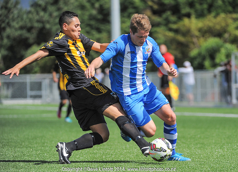 Marcello Riley (right) tries to get past Team Wellington's Janek Chmielewski during the ASB Youth League football match between Team Wellington (black and yellow tops) and Nelson Marlborough Falcons (blue and white striped tops) at Memorial Park Artificial Turf, Petone, Wellington, New Zealand on Sunday, 21 December 2014. Photo: Dave Lintott / lintottphoto.co.nz