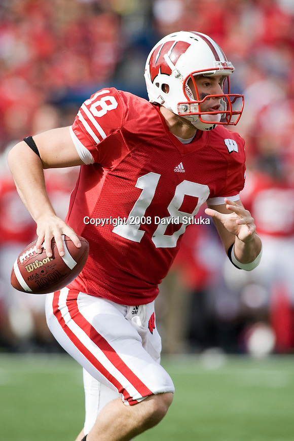MADISON, WI - OCTOBER 25: Quarterback Dustin Sherer #18 of the Wisconsin Badgers scrambles against the Illinois Fighting Illini at Camp Randall Stadium on October 25, 2008 in Madison, Wisconsin. The Badgers beat the Fighting Illini 27-17. (Photo by David Stluka)