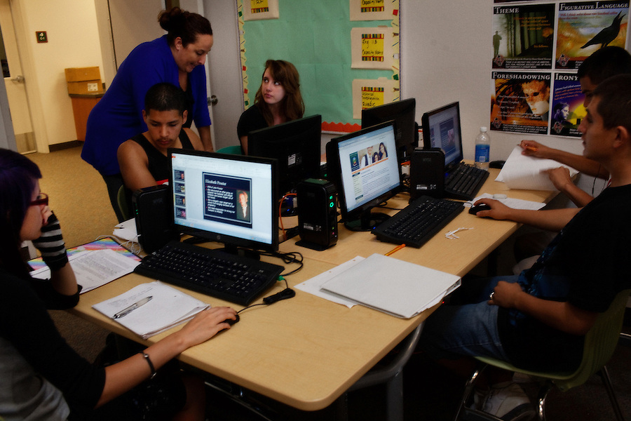 Lindsay, California, September 5, 2012 - Lindsay High School English teacher Amalia Lopez works with advanced student Karly Higgins on her senior project which requires her to work shadow someone in the field she is interested in persuing, which in her case is astrophysics. Lopez sets up websites for her advanced students allowing them greater access to research on their own. Karly is graduating a full year early and has already passed her AP tests. ..Lindsay High School began building a competency-based education model about 7 years ago, fully implementing it just over three years ago and is set to graduate its first class this school year. This model does away with traditional grading and pass/fail for grades. Instead students are expected to achieve proficiency in a range of areas in each class, where a 3 (equal to a traditional B) is passing; A 4 is considered intensive and usually denotes college bound. Says Principal Jaime Robles, ?This allows students to learn at there own pace. If a student is advanced, they can move ahead, and if a student is lagging, they get the support they need.? Part of this model allows for students who are more advanced dig deeper and push harder and truly move ahead of others. Because they are ahead, some spend the extra time learning more, others take concurrent classes at the nearby community college and some choose to graduate early to start their path. ?Each student has their own set of goals,? says English teacher Amalia Lopez, ?Whatever their goals are, we support them.?.Slug: DD_ CompetencyByline: Daryl Peveto / LUCEO for Education Week